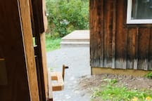 The outhouse is a short distance from the Brown Bear connected by a stone path.