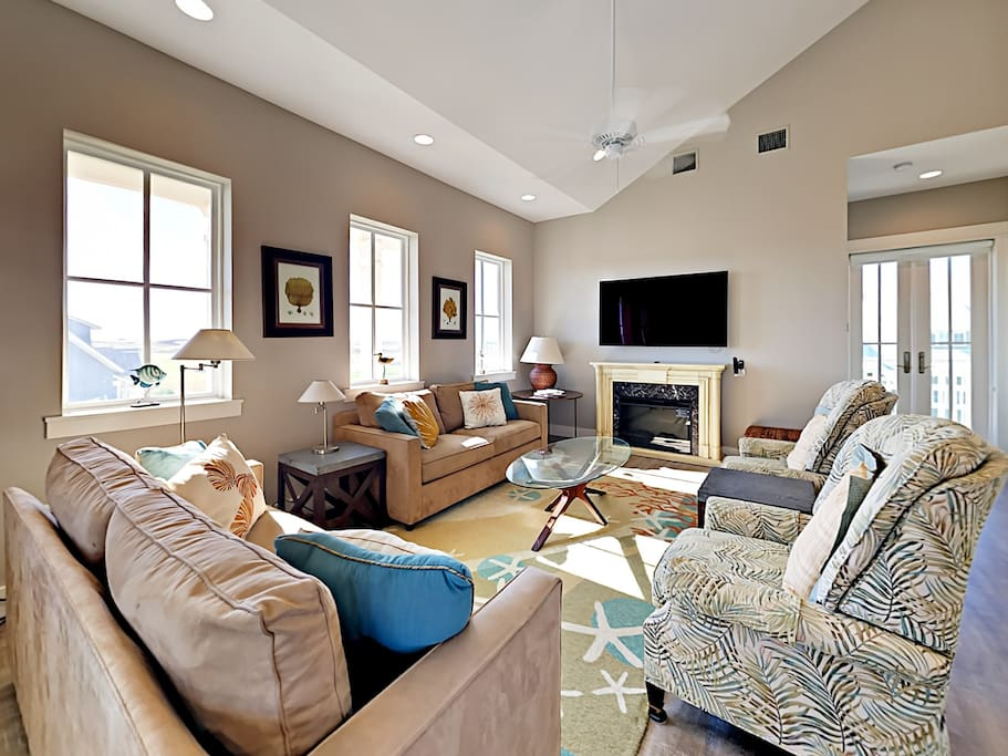 Cozy up by the fireplace of this home and watch your favorite shows on the enormous flat screen TV.