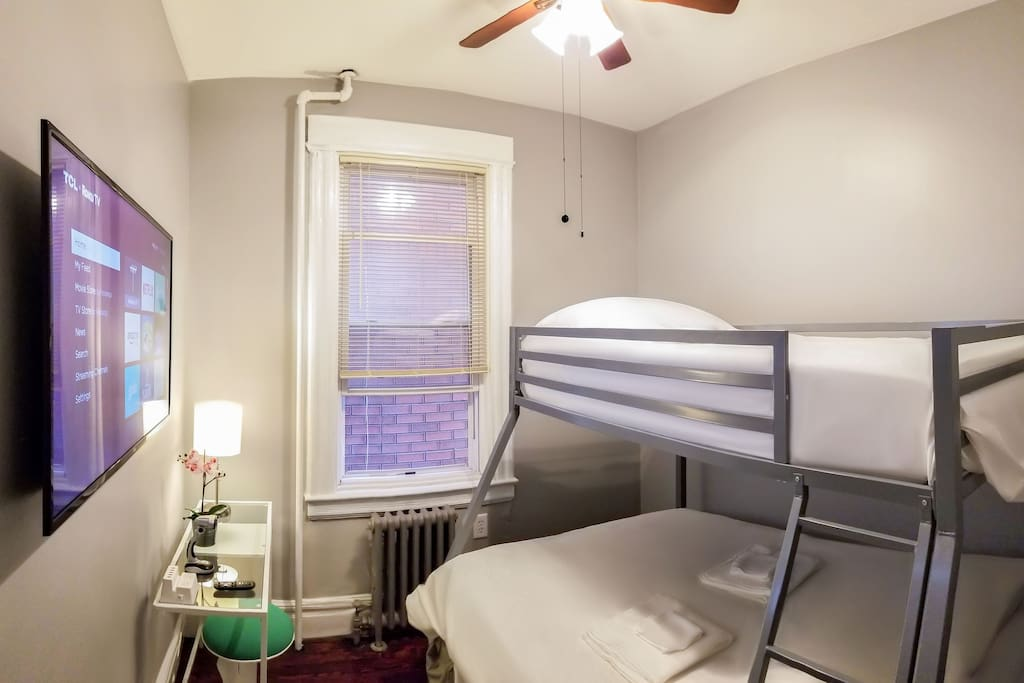 Bedroom accommodates up to 3 guests with a double bed on bottom bunk and single bed on top bunk, both furnished with top-rated gel memory foam mattresses