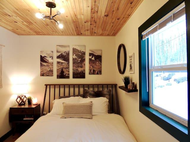 Queen-size bed in the first floor bedroom