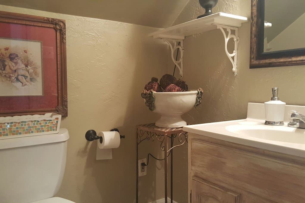 Private powder room. Shower downstairs