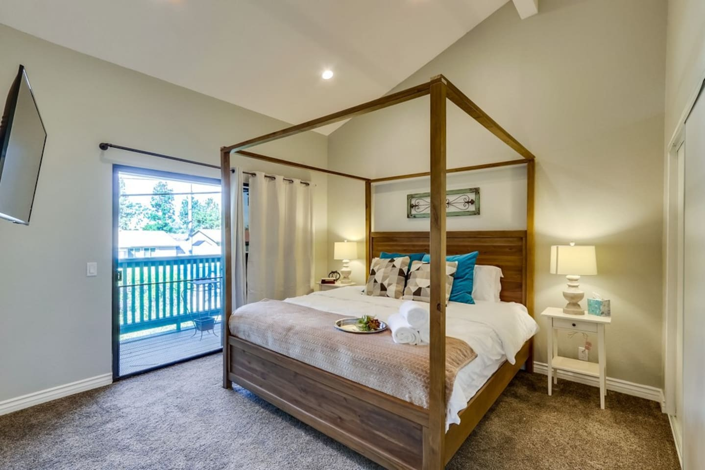 """This is the master bedroom with a private bathroom, shower, tub and 2 sinks. also 2 large closets, 55"""" smart TV and balcony."""