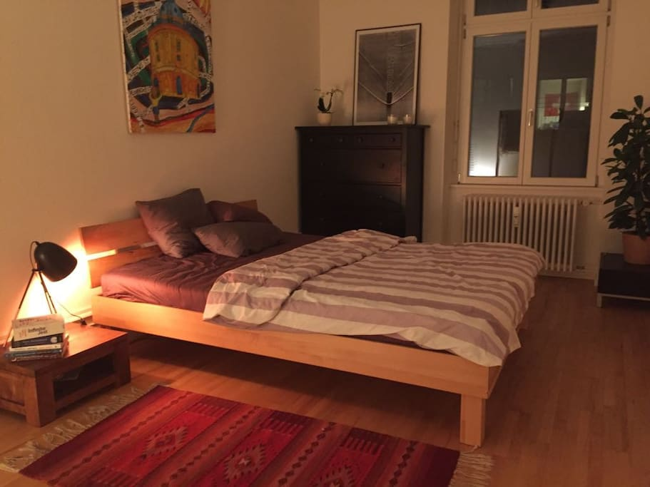 Spacious bedroom (by night)