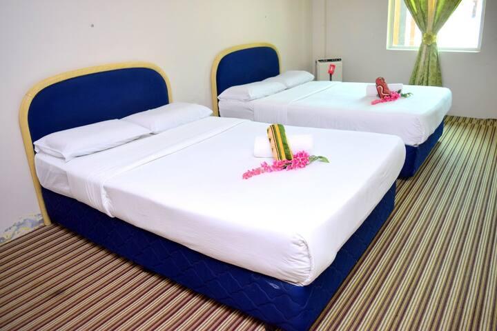 Homey Standard Room at An-Nahdhoh Inn