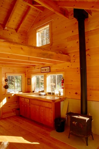 A small woodstove keeps you cozy, basic essentials in the 'kitchen' with the sleeping loft above.  A notch above the old camps of the Adirondacks, but still a good back woods experience.