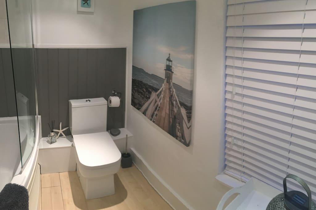 Clean, spacious, relaxing bathroom/shower/bath space...