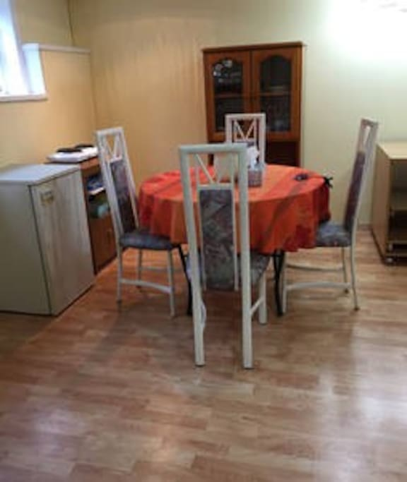 Dinning area with a stove, refrigerator, microwave.