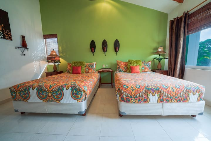 - Guest suite 1 with 2 double beds and en suite bathroom