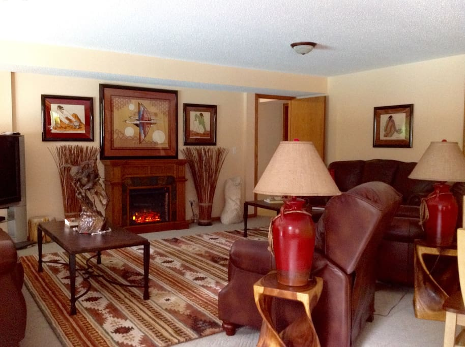 The living room fireplace wraps you in warmth, and dispels any lingering chill.