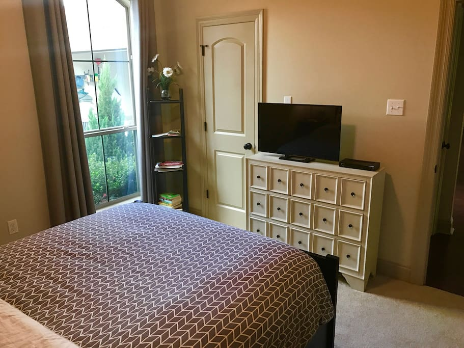 Your bedroom.  Window overlooking front of home and TV with over 450  channels.
