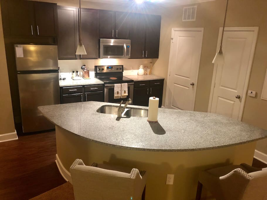 Updated kitchen with granite countertops and island seating