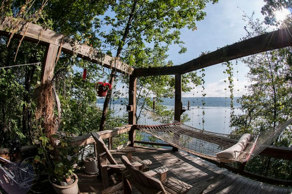 Private deck with hammock, lounge chairs, and beautiful vines and flowers in the warmer months. Watch the animal life come to you as we will give you food to place inside the feeders to watch eclectic birds (woodpeckers, blue jays, etc.) & chipmunks & squirrels + their young.