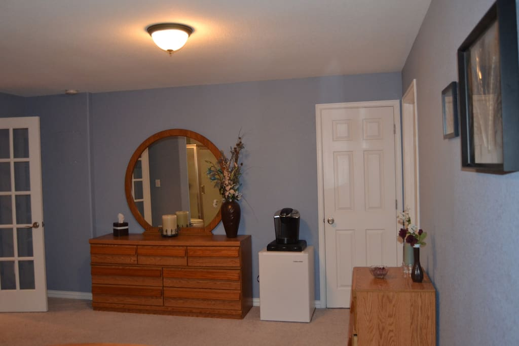 Large bedroom with dresser and closet.