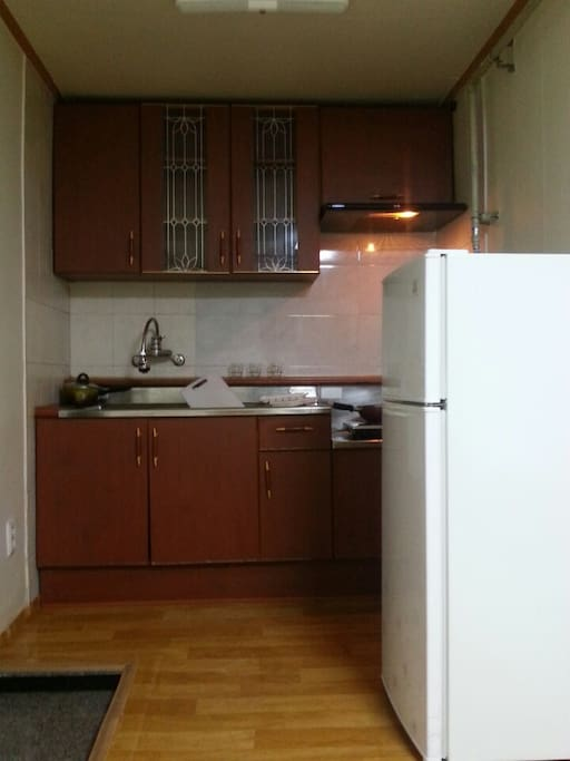 Equiped Kitchen with basic cooking pans and tools.