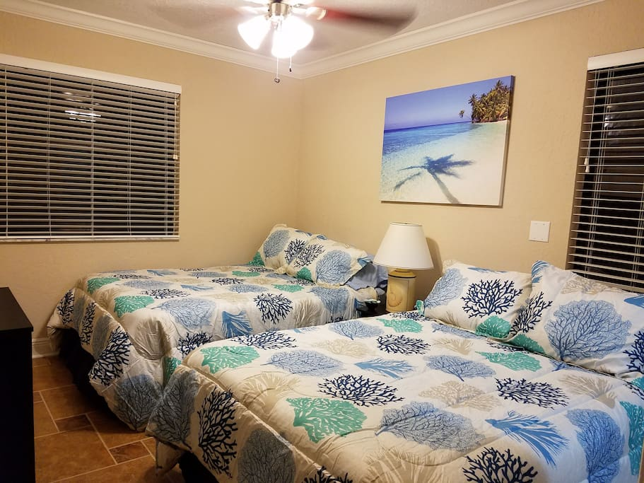 one comfortable room with 2 full beds for 4 guests