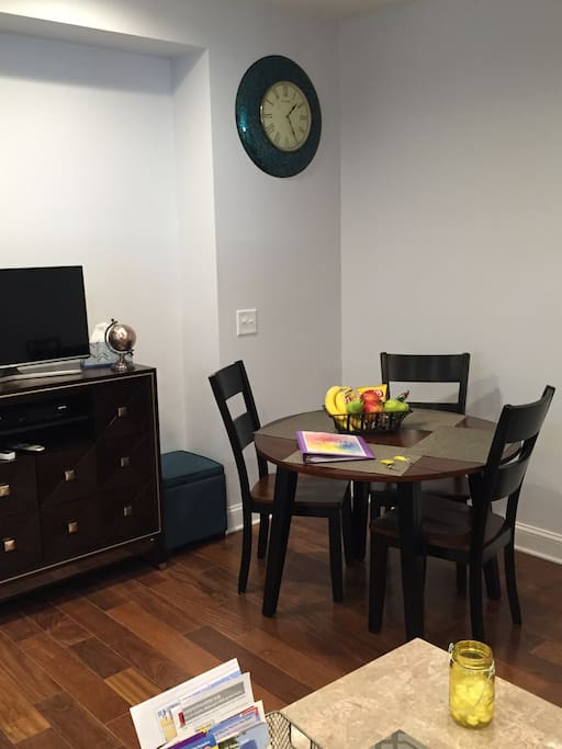 Spacious dining room with expandable table (seats up to 6).  TV/free WiFi.