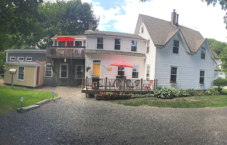 Panoramic view of the house.  Cathy and George are to be found in the Caretaker Apartment on the far left - the red door!