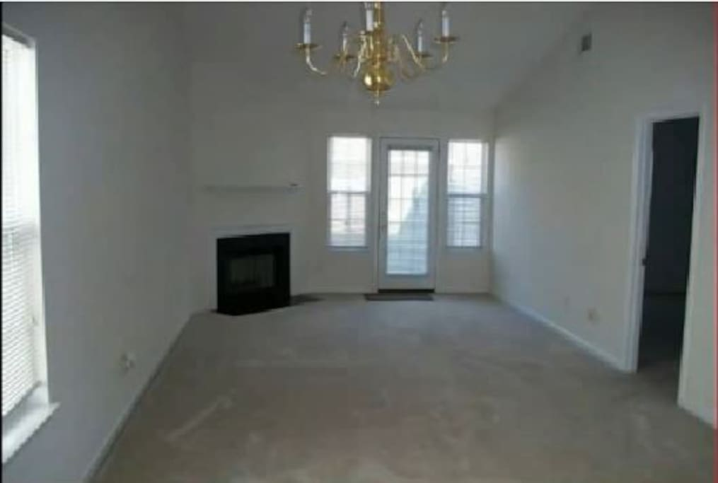Living/Dining Room with wood burning fireplace
