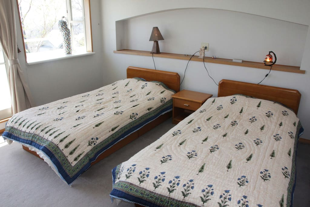 Twin bed with ocean view