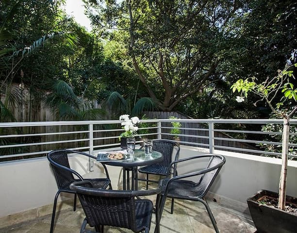 Private sunny outdoor balcony with weber BBQ
