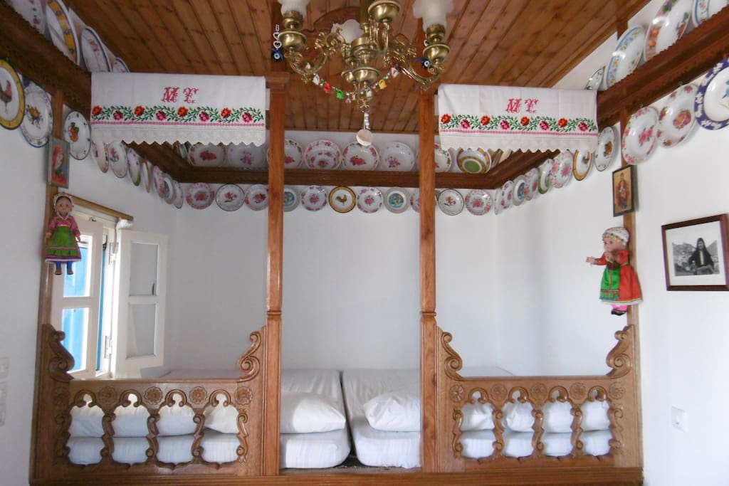 "Cottage ""Elaeon"", the inside of the main house with the traditional ""sofa"" (king size bed), view 1."