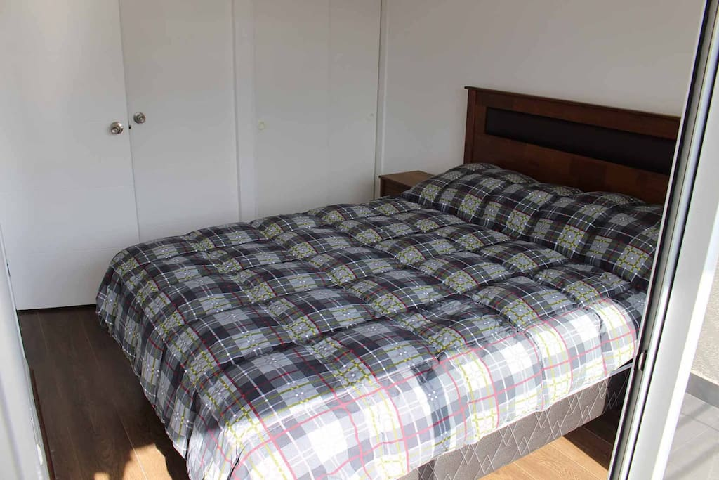 bedroom: double bed and closet