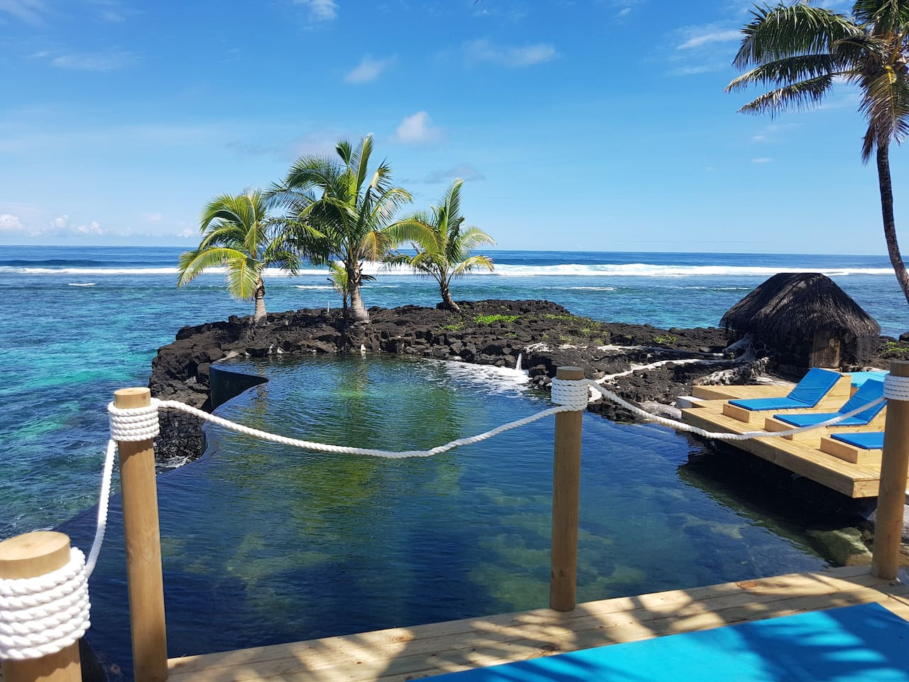 Our Ocean water infinity pool with comfy daybeds for relaxation and a cool down.