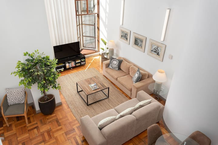 Very Spacious, open-plan living area with original parquet flooring. TV with Netflix and good WiFi in the apartment.