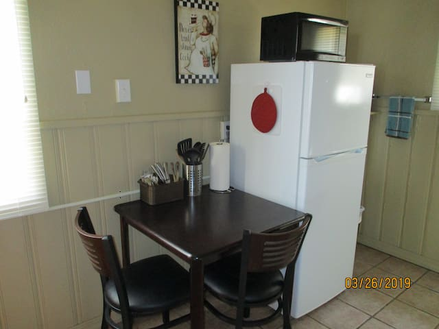 kitchen table, microwave and toaster oven