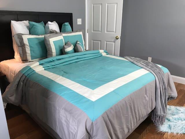 Upstairs bedroom with aqua blue
