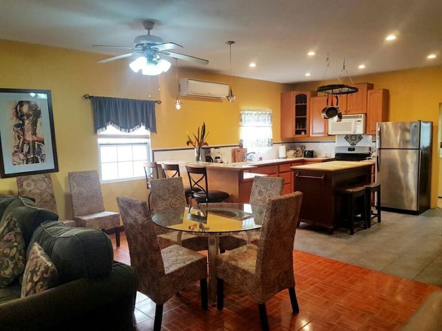 Plenty of space to dine - table, bar and kitchen island seating