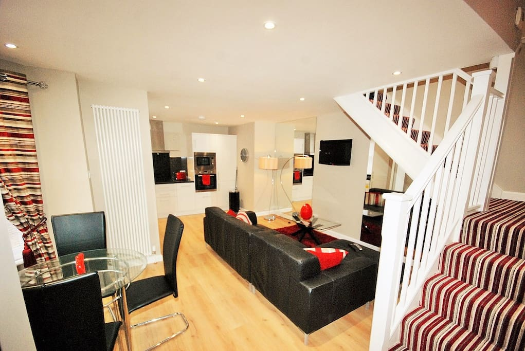 Open plan living...  tv connected to dvd and freesat/freeview box which are stored under stairs.  Wifi available throughout the apartment.
