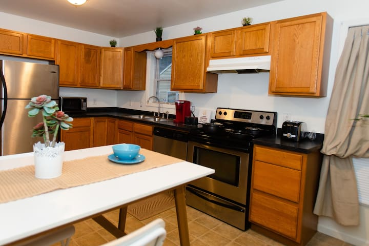 Full modern kitchen for cooking or drinking too much wine with work friendly table and chairs.