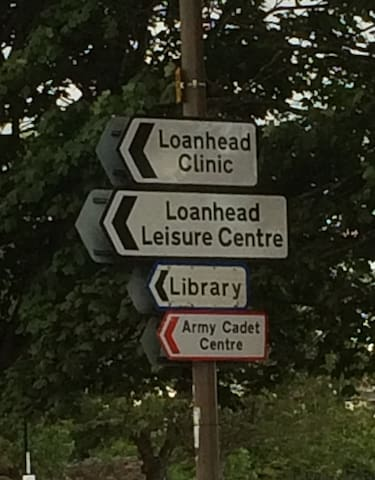 Slightly before the bus stop you get off at, follow these signs to our home.