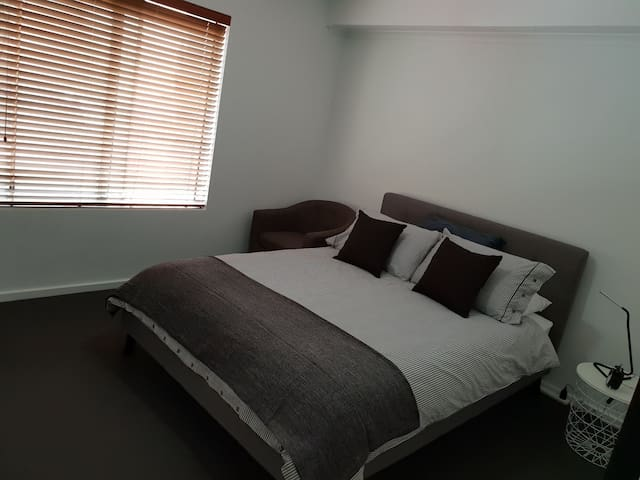 Large neat bedroom, CBD group of apartments