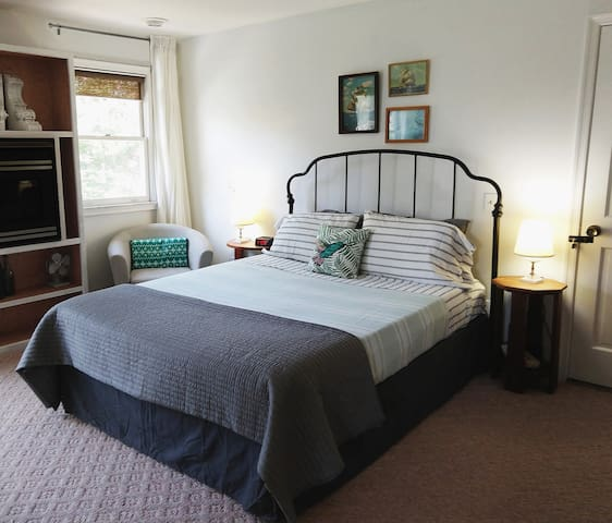 Bedroom with queen bed & riverfront balcony