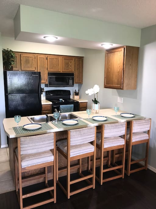 Kitchen includes, fridge with ice maker, microwave, stove, coffee pot and all the essentials for dinnerware and cookware.
