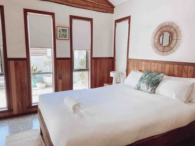 Master bedroom with queen bed overlooking the private courtyard