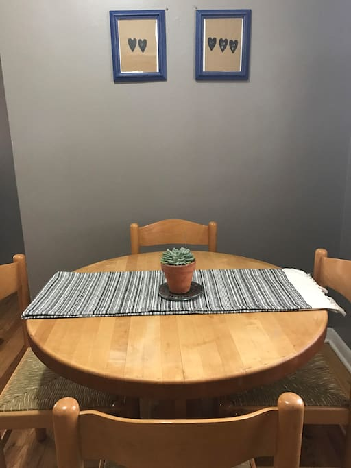 Cozy table off the kitchen for shared meals! Enjoy the hand printed artwork by one of Rae's Chicago friends.