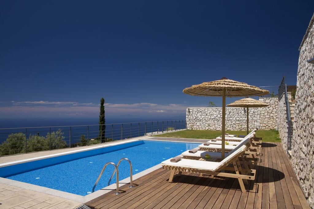 Relax by the pool of Villa Artemis and enjoy the endless sea view
