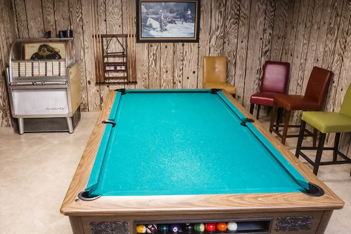 Pool table in recreation area.