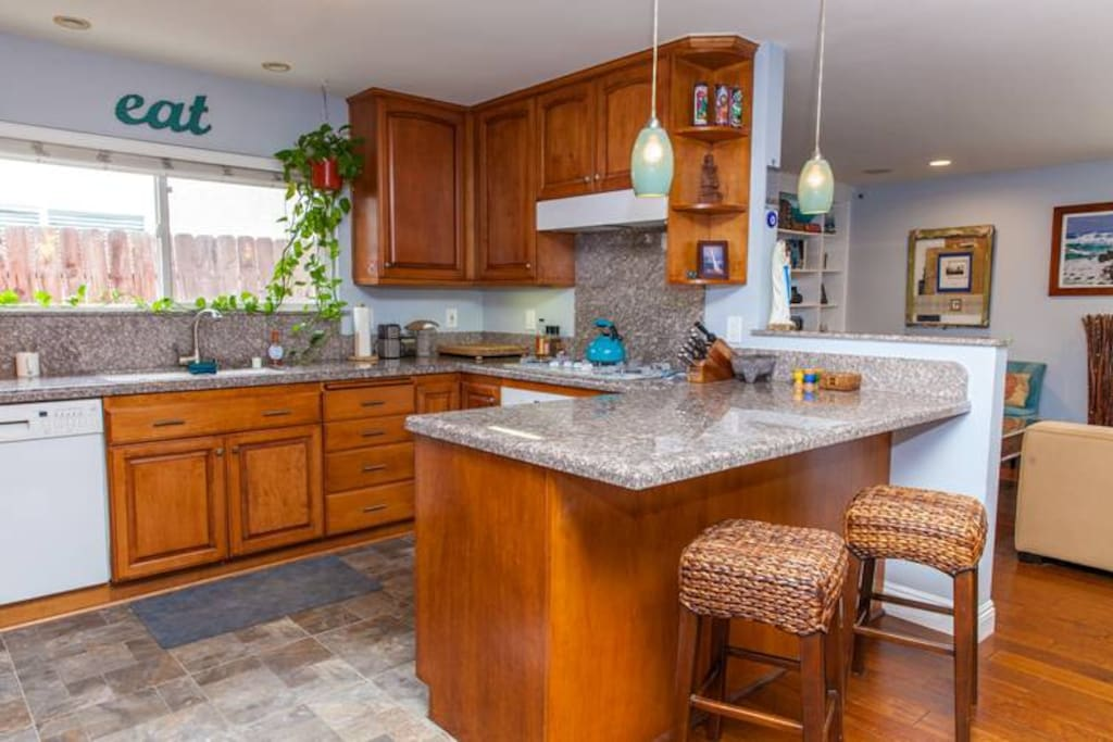 Open kitchen with bar stools, great for families
