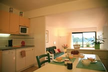 Prepare meals in the small kitchen and enjoy them at the dining table.