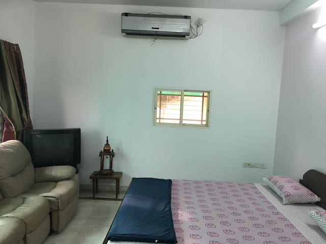 Air Conditioner on the wall next to the bed