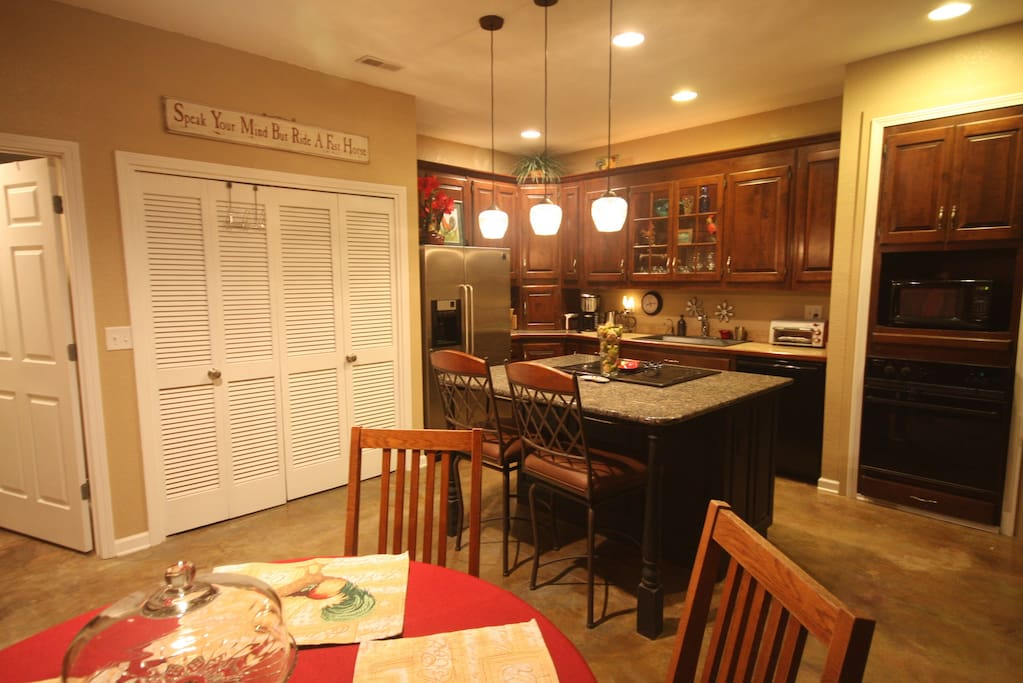 Eat at granite counter and dining table for four.