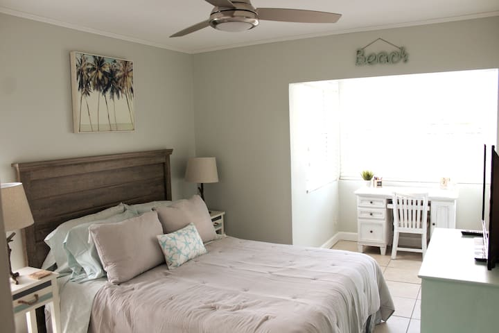 Bedroom one with a comfy queen size mattress, work area and Roku TV