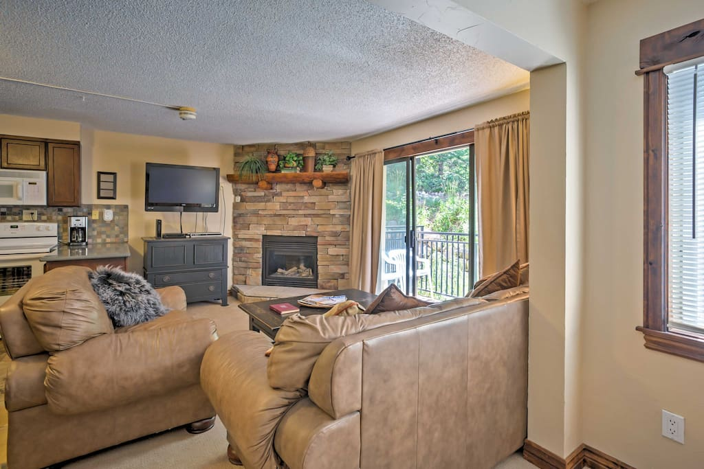 The living room offers a comfortable spot to relax during your downtime.