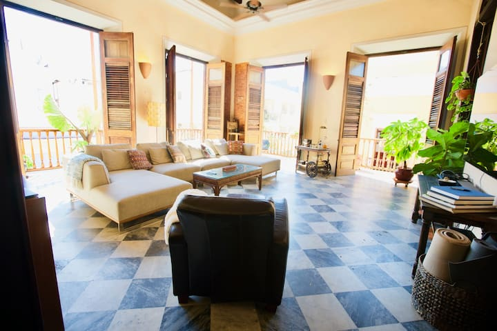 In the second floor apartment of this open floorplan home, you have views of the streets outside as well as the dining room, kitchen and interior courtyard from the bohemian living room. Look down on two of the most popular streets in Old San Juan from the wrap around balconies.
