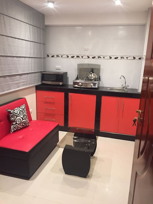 Each mini apartment has  microwave, mini bar, Kitchener, small living room, cups, plates, glasses, everything  to enjoy and make you feel home .