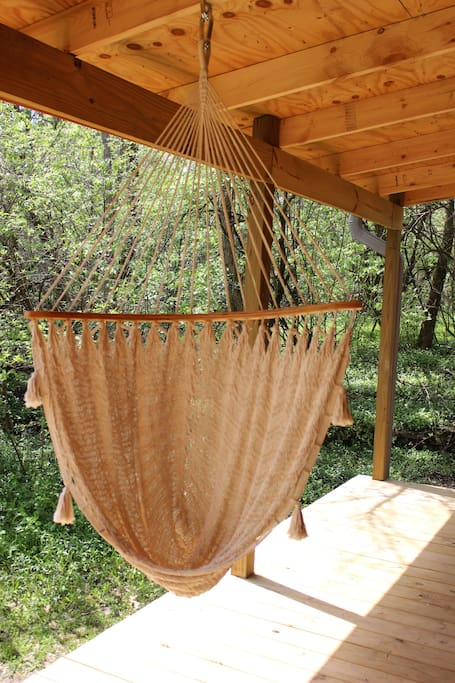 Hammock swing on back deck for relaxing and enjoying the sounds of nature
